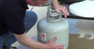 warm water cool hand propane tank trick